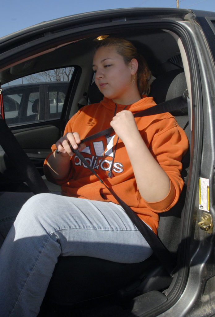 Jessica Houland 17 Buckles Up Before Leaving The Lawrence High School Parking Lot On Thursday Kansas Senate Has Passed SB 211 Which Would Make It A