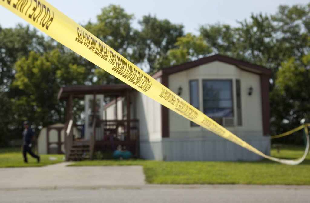Police Tape Stretches Across The Street In Front Of The Mobile Home Lot 520  In The Easy Living Mobile Home Park At 3323 Iowa.