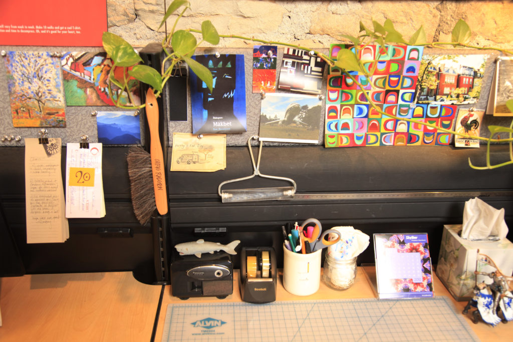 Charmant Chris Ralston, One Of Several Art Directors At Callahan Creek, 805 Mass.,  Keeps His Workspace Creative But Neatly Organized.