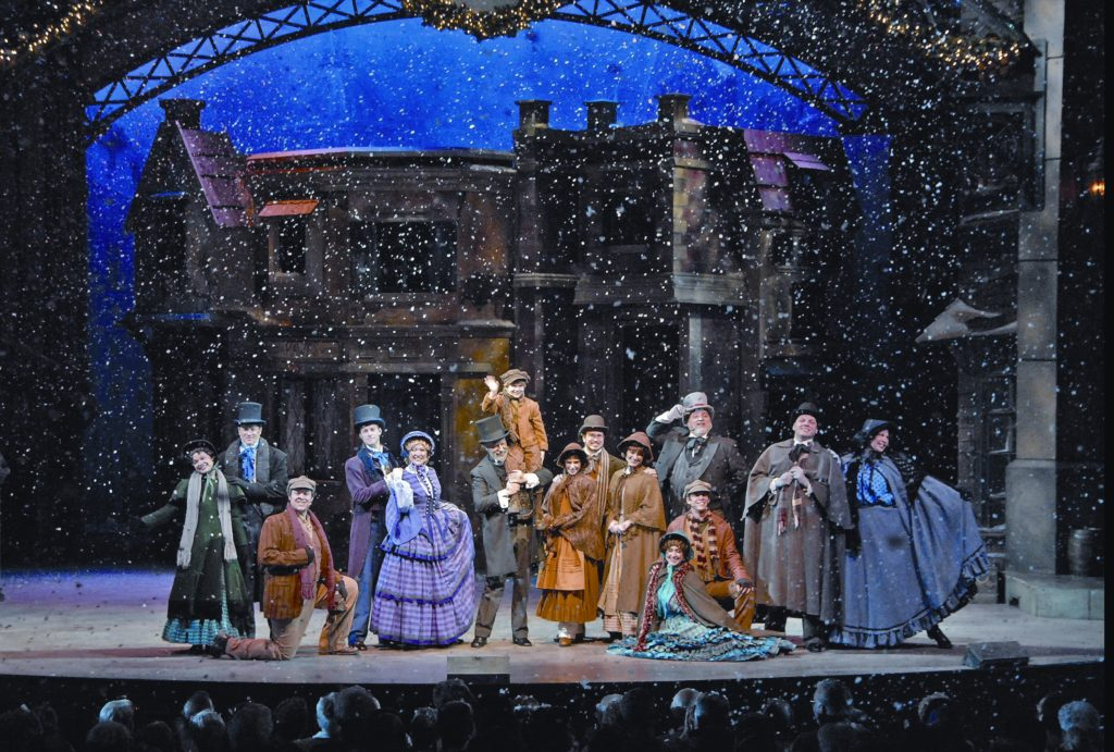 snow falls on the cast members of the broadway style musical a dickens christmas carol at silver dollar city - Silver Dollar City Christmas