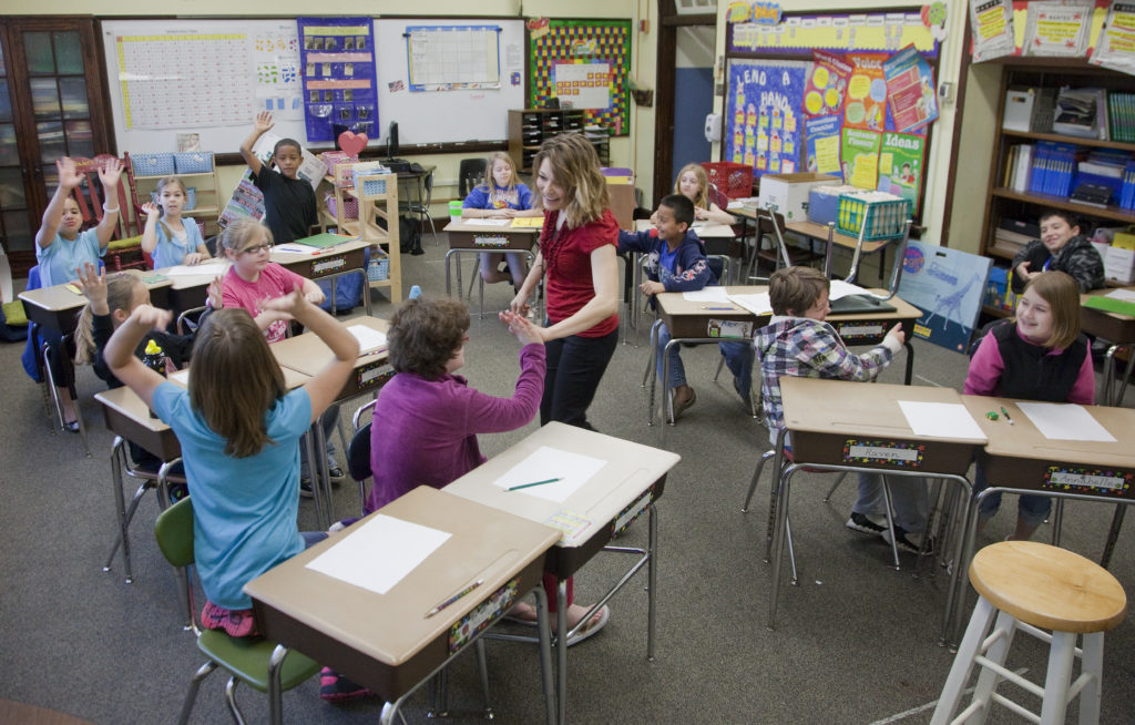 Comparison of large small class sizes underscores importance of woodlawn school teacher rachel gilmore goes around her classroom to join her fourth graders in a morning high five greeting her class of 14 students is the m4hsunfo