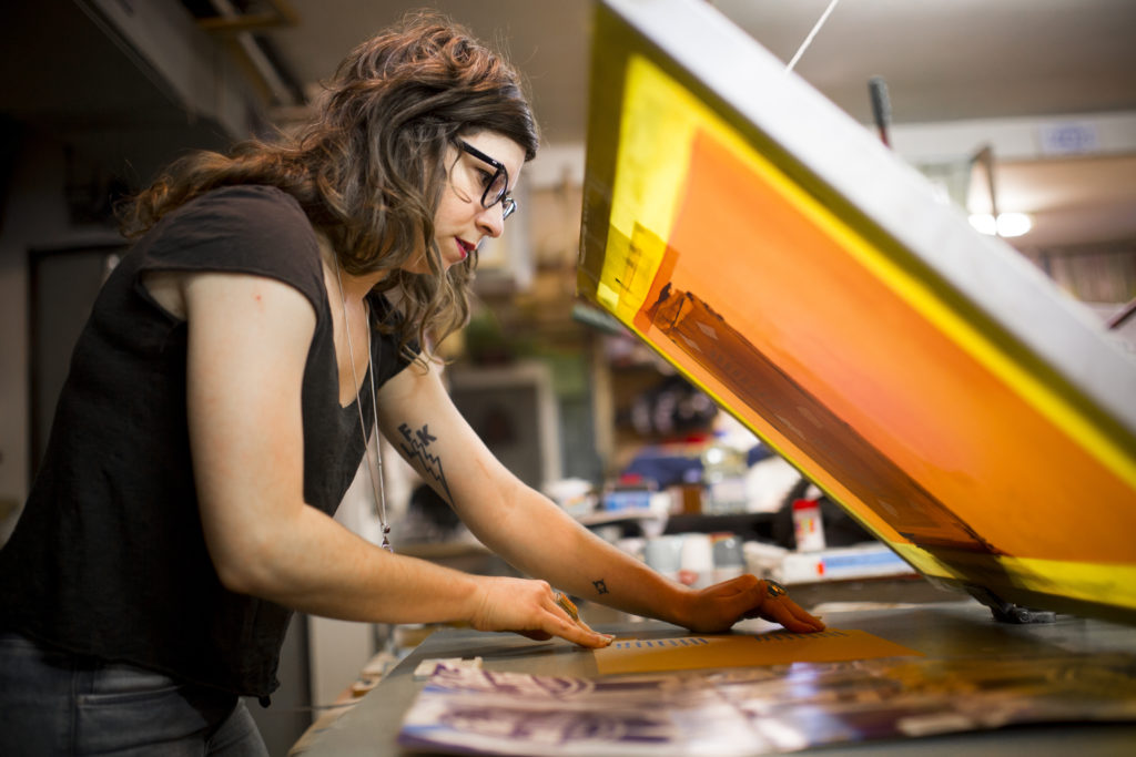 Homemade for the holidays local artists craft greeting cards by leslie kuluva lays a hanukkah card within a screen printing press as she prepares to add another color on friday dec 12 2014 at her studio 518 e eighth m4hsunfo