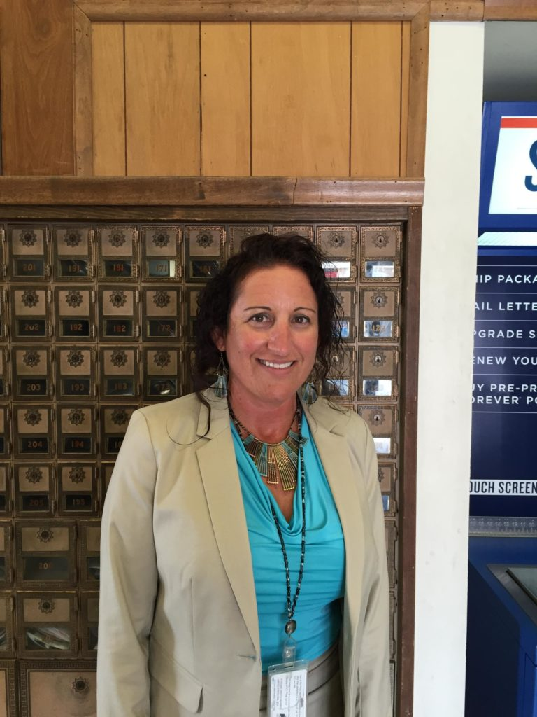 New postmaster takes over in Lawrence, hopes to curb long lines ...