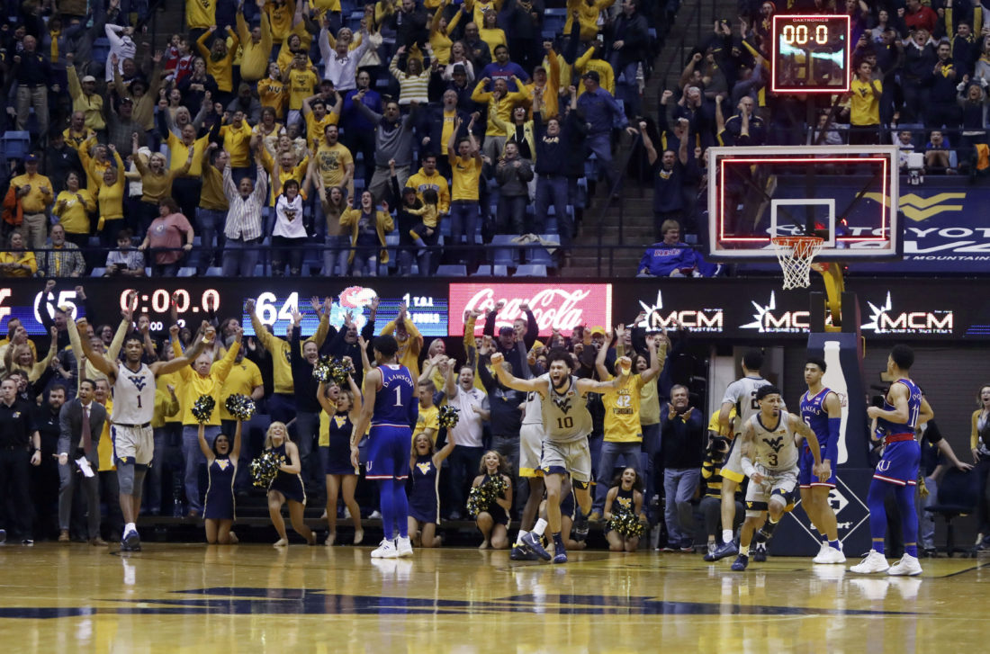 West Virginia upsets No. 7 Kansas late in thriller