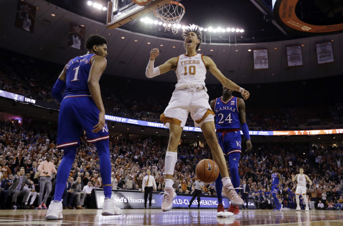 College Basketball Roundup: Texas men top Kansas 73-63