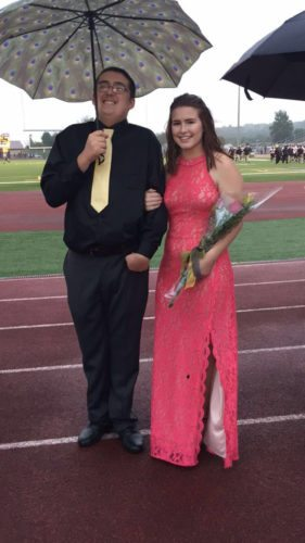 Senior Noah Siegle escorts Tess Bechdel at the Bald Eagle Area High School Homecoming game where Bechdel was crowned homecoming queen.