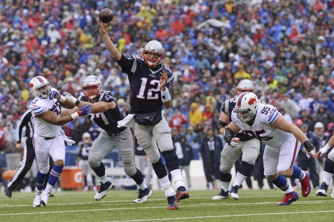 New England Patriots quarterback Tom Brady (12) throws a pass to Danny Amendola for a touchdown during the first half of an NFL football game against the Buffalo Bills Sunday, Oct. 30, 2016, in Orchard Park, N.Y. (AP Photo/Adrian Kraus)