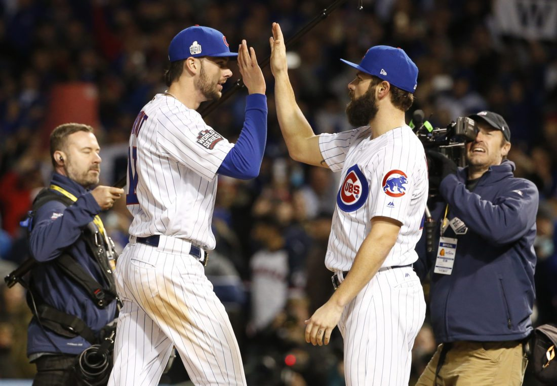 Chicago Cubs' Kris Bryant, left, celebrates with Jake Arrieta after Game 5 of the Major League Baseball World Series against the Cleveland Indians, Sunday, Oct. 30, 2016, in Chicago. The Cubs won 3-2 as the Indians lead the series 3-2. (AP Photo/Nam Y. Huh)