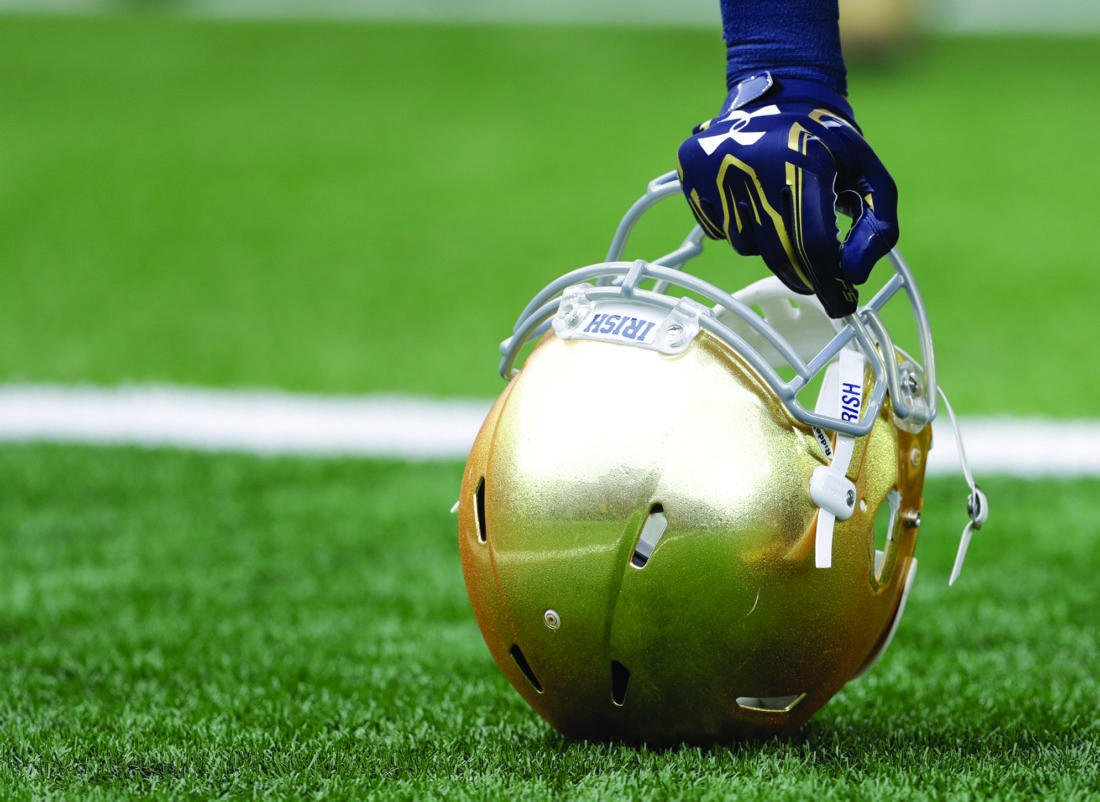 A Notre Dame player holds his helmet after running onto to field before an NCAA college football game Saturday, Oct. 29, 2016, in South Bend, Ind.   (AP Photo/Darron Cummings)