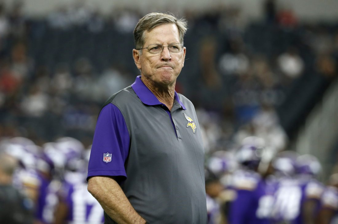 FILE - In this Aug. 29, 2015, file photo, Minnesota Vikings offensive coordinator Norv Turner watches the team warm up before a preseason NFL football game against the Dallas Cowboys, in Arlington, Texas. Vikings offensive coordinator Norv Turner has resigned. He's been replaced on an interim basis by Pat Shurmur. The Vikings announced the news on Wednesday, Nov. 2, 2016, two days after their second consecutive defeat. (AP Photo/Tony Gutierrez, File)