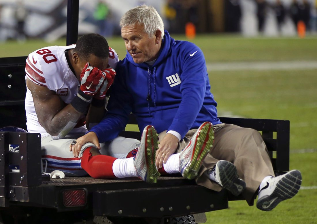FILE - In this Oct. 12, 2014, file photo, New York Giants wide receiver Victor Cruz, left, is carted off the field during the second half of an NFL football game against the Philadelphia Eagles in Philadelphia. Playing the Eagles always had a special meaning for Cruz. This year, even more so. The last time Cruz faced the Eagles was Oct. 12, 2014, and it almost cost the New York Giants receiver his career when he tore the patellar tendon in his right knee. (AP Photo/Matt Rourke, File)
