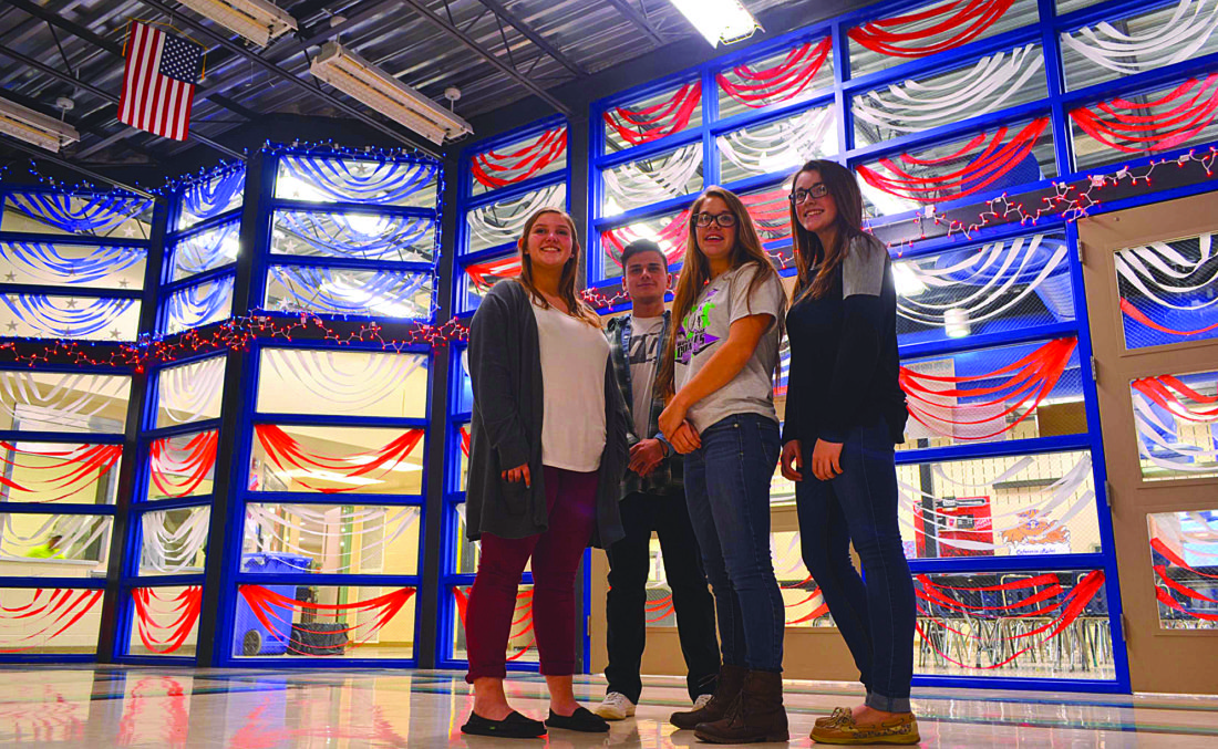 PHIL MAPSTONE/For The Express Creators of a unique American Flag in the windows of the cafeteria at Central Mountain HIgh School are, from left, Jayden Genua, Bobby George, Sarah Probst and Abby Weaver. Mrs. Gloria Bowers, CMHS art teacher, pushed the project along and mentored the students.