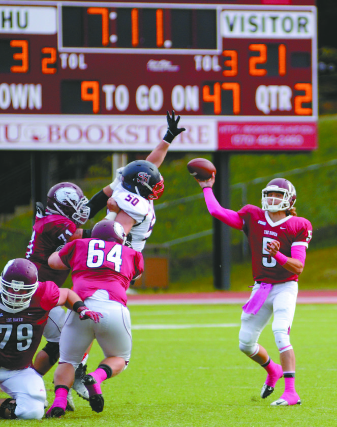 Lock Haven University quarterback Caleb Walton (5) passes against Shippensburg University. LHU has won 4 out of its last 5 games.