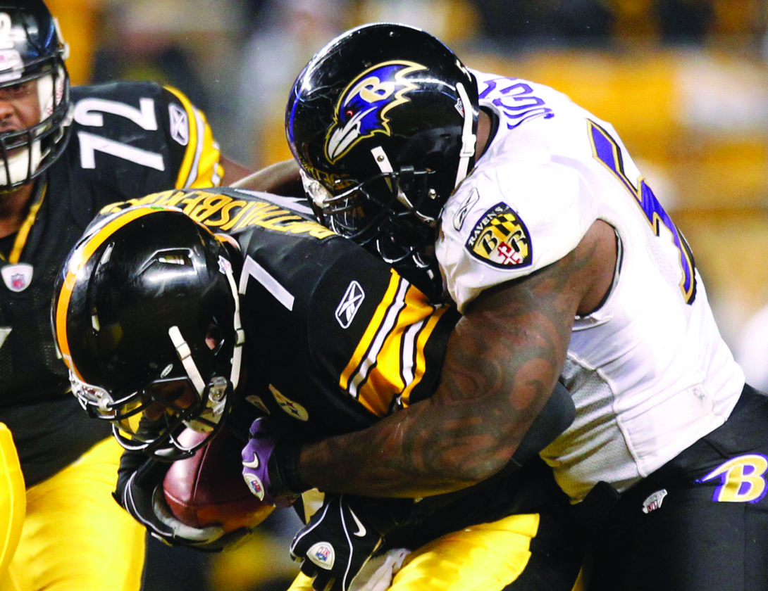 FILE - In this Jan. 15, 2011, file photo, Baltimore Ravens linebacker Terrell Suggs, right, sacks Pittsburgh Steelers quarterback Ben Roethlisberger during the first half of an NFL divisional playoff football game in Pittsburgh. Suggs is one of the few remaining stars in a rivalry that almost always had playoff ramifications and occasionally extended into the postseason. On Sunday, first place in the AFC North will be at stake when Pittsburgh comes to town. (AP Photo/Keith Srakocic, File)