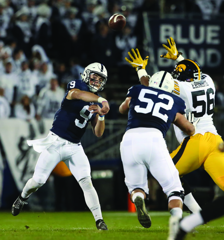 Penn State quarterback Trace McSorley (9) throws a pass against Iowa during the first half of an NCAA college football game in State College, Pa., Saturday, Nov. 5, 2016. (AP Photo/Chris Knight)