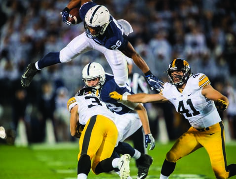 Penn State running back Saquon Barkley leaps over Iowa defenders during an NCAA college football game in State College, Pa., Saturday, Nov. 5, 2016. Penn State won, 41-14. (Abby Drey/Centre Daily Times via AP)