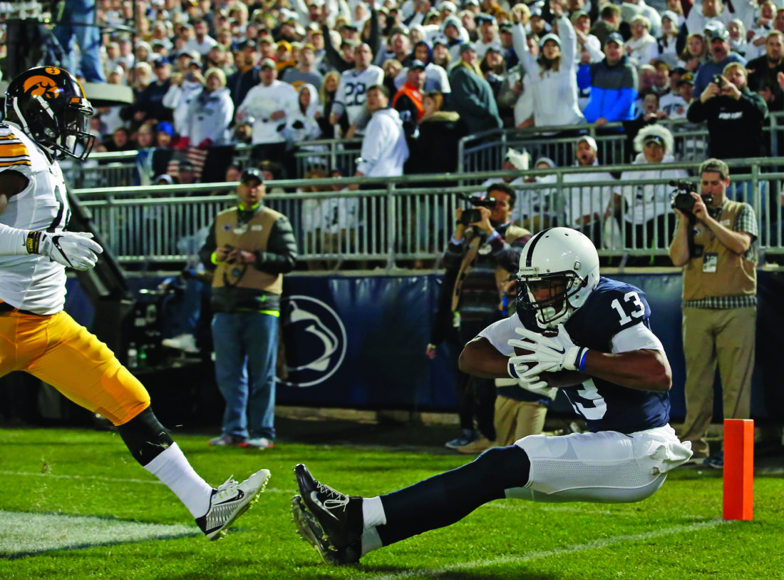 Penn State's Saeed Blacknall (13) makes a catch in the end zone for a touchdown against Iowa during the first half of an NCAA college football game in State College, Pa., Saturday, Nov. 5, 2016. (AP Photo/Chris Knight)
