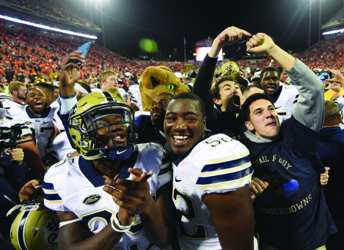 Pittsburgh's Elijah Zeise (25) and teammate Shakir Soto (52) celebrate with fans on the field after defeating Clemson 43-42 in an NCAA college football game on Saturday, Nov. 12, 2016, in Clemson, S.C. (AP Photo/Rainier Ehrhardt)
