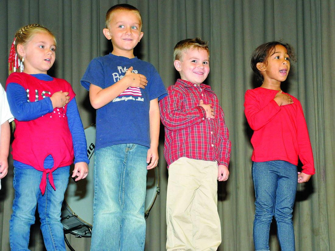 KEVIN RAUCH/THE EXPRESS Renovo Elementary pre-school students started things off. From left, Brielle Riggle, Quentin Kalafut, Braden Casper and Marra Ballard.