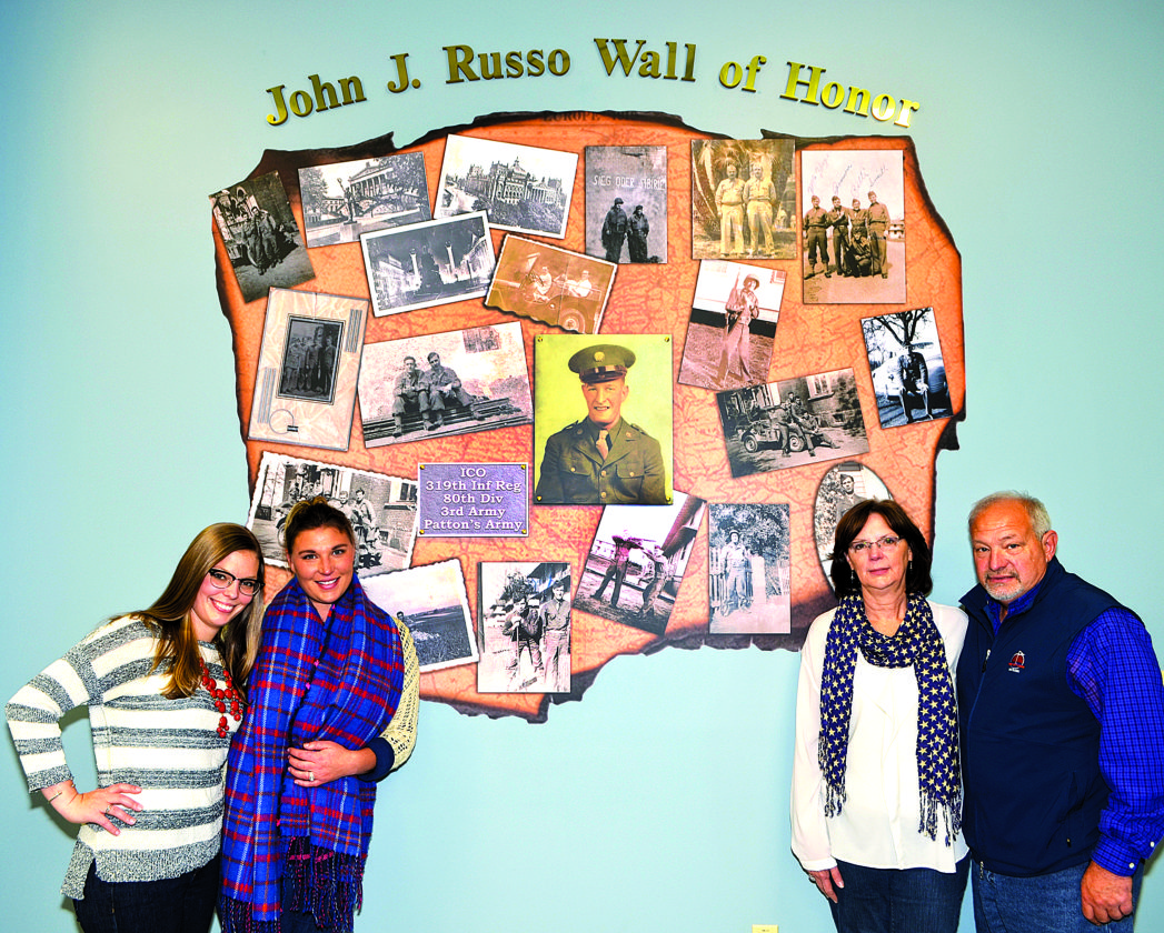At the Wall of Honor for John Russo, above, are from left, Cristina, Carley (Anderson), Shelia, and Jim (son) Russo.