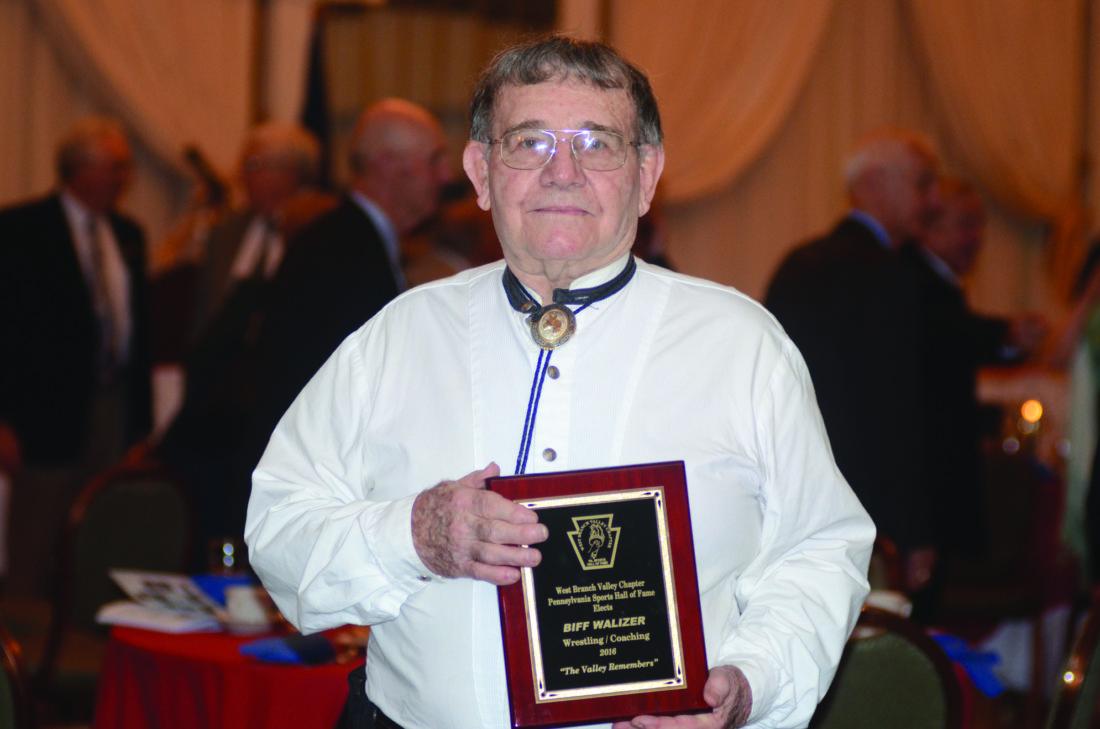 Biff Walizer poses with his plaque afer the ending of the Pennsylvania Hall of Fame Ceremony in Williamsport, PA on Sunday, Nov. 13, 2016.