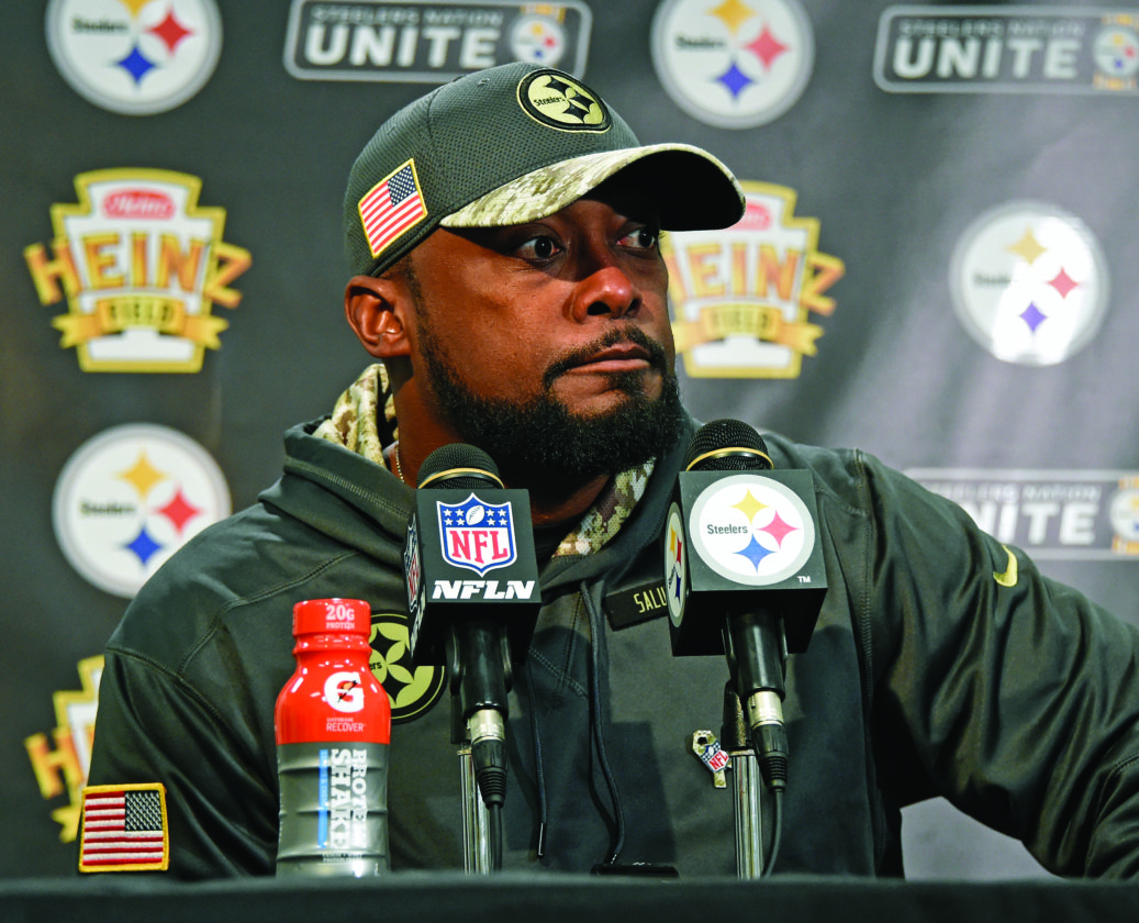 Pittsburgh Steelers head coach Mike Tomlin listens to a reporter's question after an NFL football game between the Steelers and the Dallas Cowboys in Pittsburgh, Sunday, Nov. 13, 2016. The Cowboys won 35-30. (Photo/Fred Vuich)