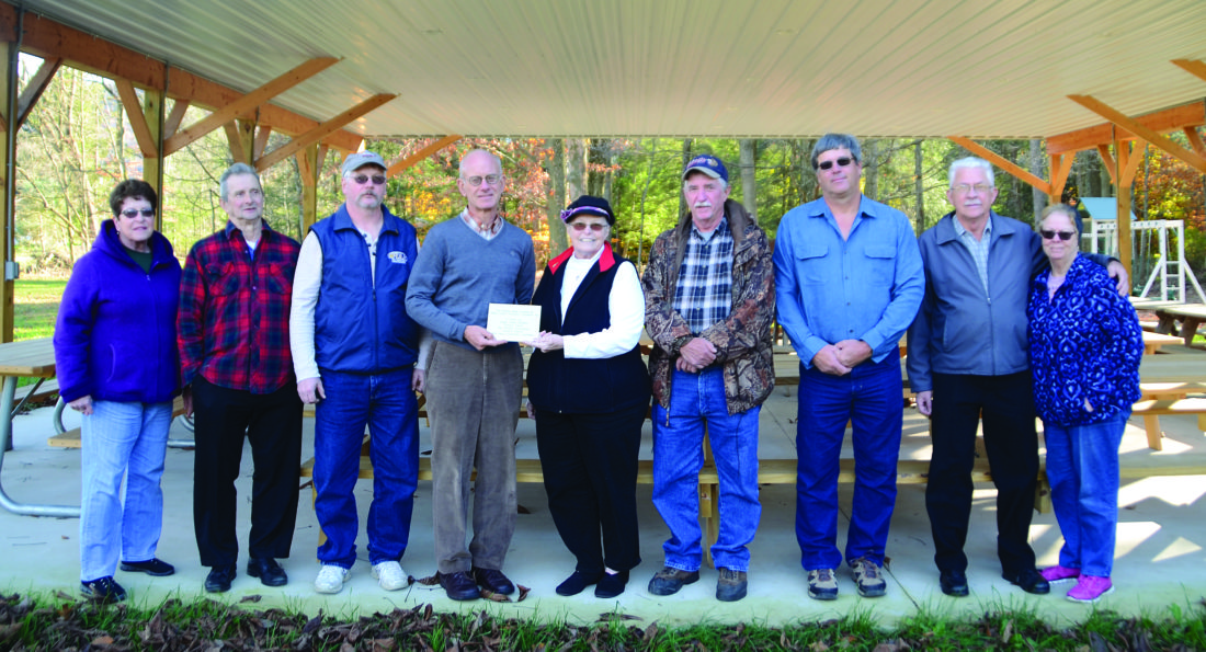 The Campground Committee along with Clinton County Community Foundation representatives, from left Verna Carey, Dr. Charles Sweeny, Dan McCormack, Foundation board members Bob Lugg and Yvonne Weaver, Grady Leiter, Jim Harbach, Farley Mitchell and Brenda Mitchell.