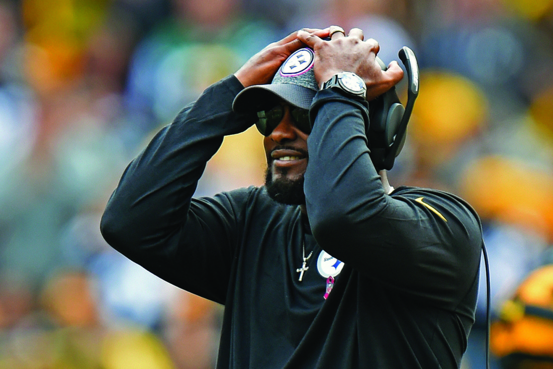 FILE - In this Oct. 9, 2016, file photo, Pittsburgh Steelers head coach Mike Tomlin reacts to a pass dropped in the end zone during the second half of an NFL football game against the New York Jets, in Pittsburgh. Tomlin likes to say he's never going to live in his fears, that includes second-guessing himself for aggressive coaching decisions that haven't worked out during his team's four-game slide. (AP Photo/Don Wright, File)