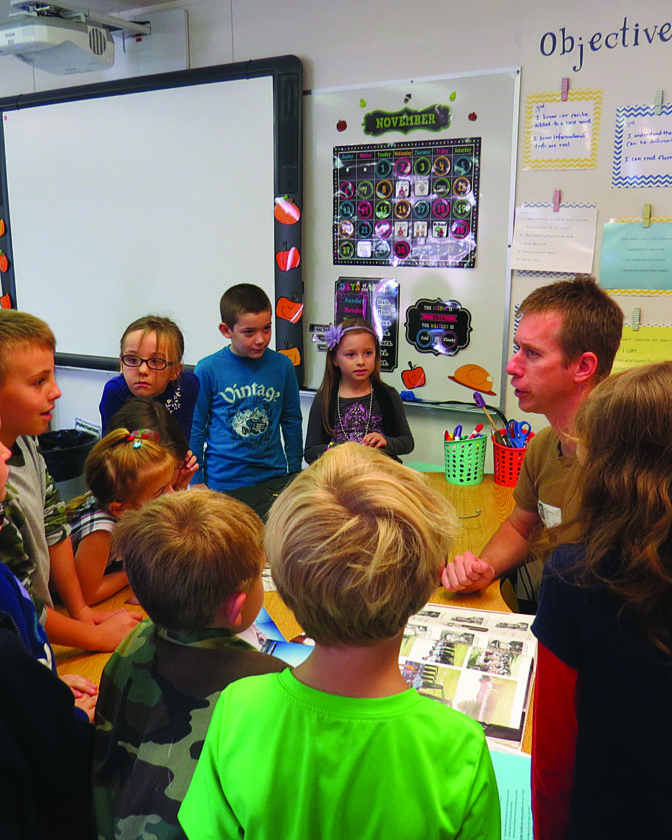 PHOTO PROVIDED Local veterans receive thanks from Marion-Walker Elementary school students.