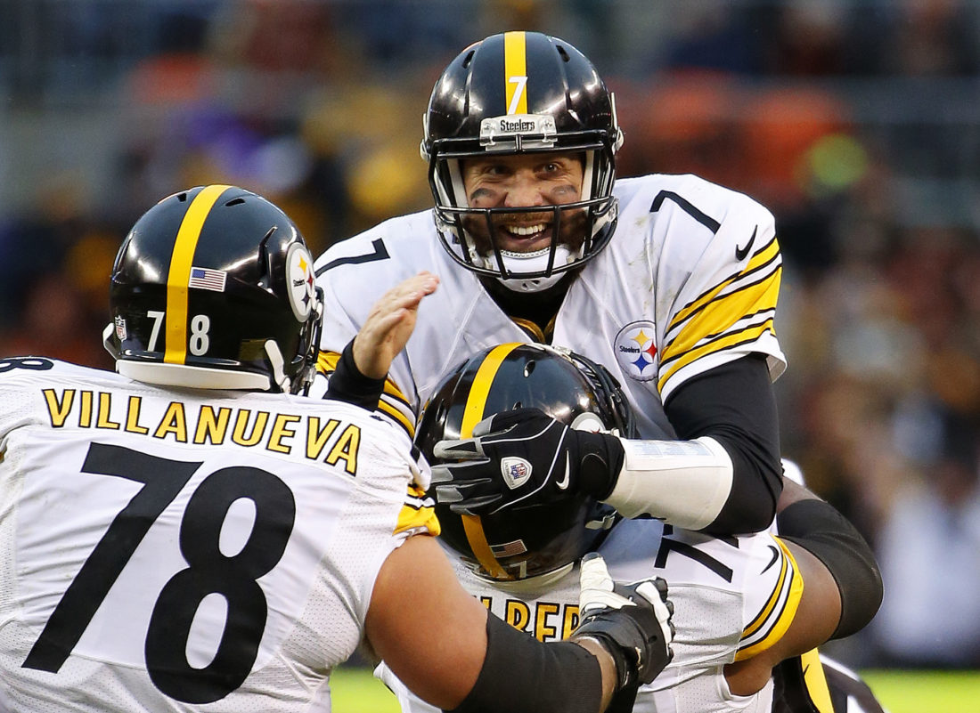 FILE - In this Jan. 3, 2016, file photo, Pittsburgh Steelers quarterback Ben Roethlisberger celebrates a touchdown pass against the Cleveland Browns with tackle Marcus Gilbert (77) and Alejandro Villanueva (78) during an NFL football game in Cleveland, Ohio. Roethlisberger, perhaps more than any other player or season, symbolizes Cleveland's general ineptitude since returning to the league in 1999. While the Steelers have thrived with the sturdy Roethlisberger behind center, the Browns have gone through 26 starting quarterbacks in 17 years and still haven't solved their QB riddle. (AP Photo/Winslow Townson, File)