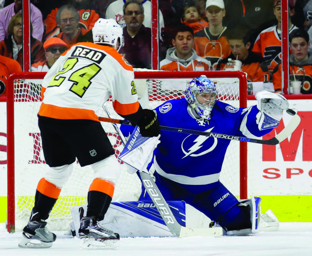 Tampa Bay Lightning's Andrei Vasilevskiy, right, blocks a shot as Philadelphia Flyers' Matt Read tries to redirect the puck during the first period of an NHL hockey game, Saturday, Nov. 19, 2016, in Philadelphia. (AP Photo/Matt Slocum)