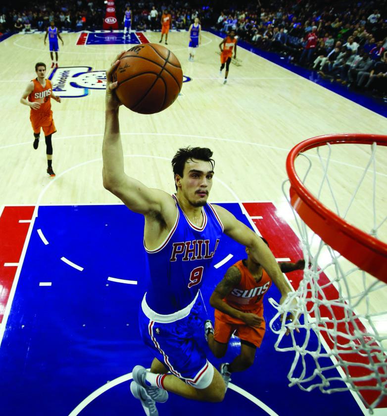 Philadelphia 76ers' Dario Saric goes up for a dunk during the second half of an NBA basketball game against the Phoenix Suns, Saturday, Nov. 19, 2016, in Philadelphia. Philadelphia won 120-105. (AP Photo/Matt Slocum)