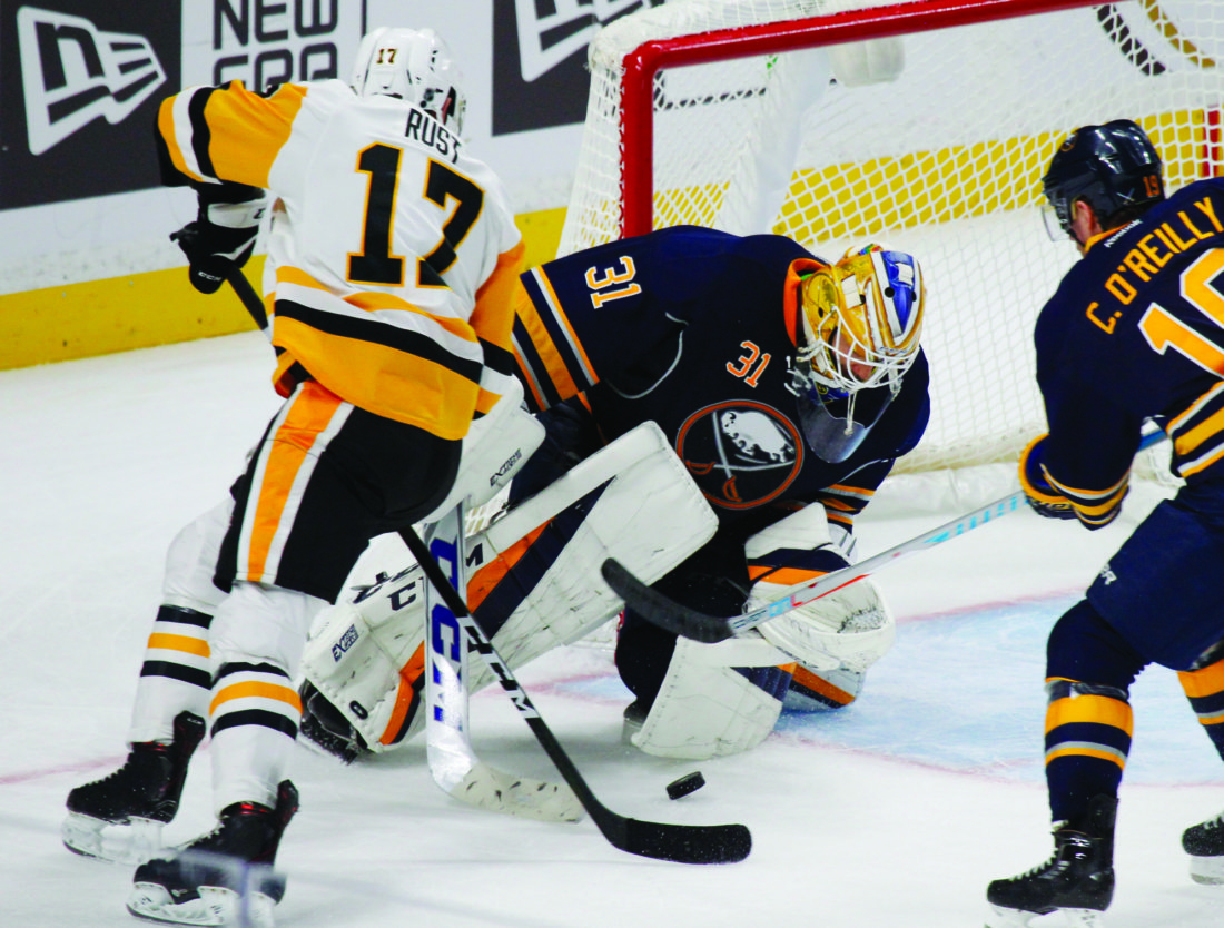 Buffalo Sabres goalie Anders Nilsson (31) stops Pittsburgh Penguins forward Bryan Rust (17) during the third period of an NHL hockey game,Saturday, Nov. 19, 2016, in Buffalo, N.Y. (AP Photo/Jeffrey T. Barnes)