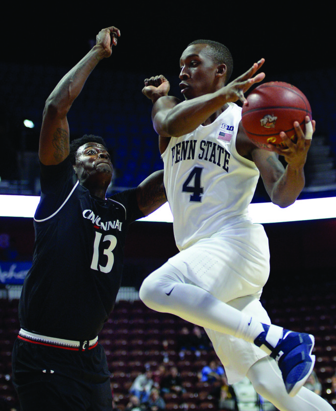 Penn State's Nazeer Bostick, right, looks to pass around Cincinnati's Tre Scott, left, in the second half of an NCAA college basketball game, Sunday, Nov. 20, 2016, in Uncasville, Conn. (AP Photo/Jessica Hill)
