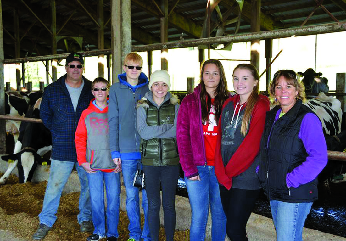 PHOTO PROVIDED Karen Bunsick, Treavor Burrows, Aaliyah McGowan, Sylvia Moore and Elliot Probst are among the Bucktail Area High School Youth Leadership Program participants. At top, they are seen at a farm in Sugar Valley with Jim Harbach, left, and Lisa Blazure, right.