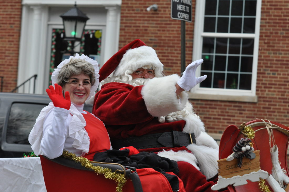 Santa and Mrs. Claus wave to Renovo parade-watchers Sunday.