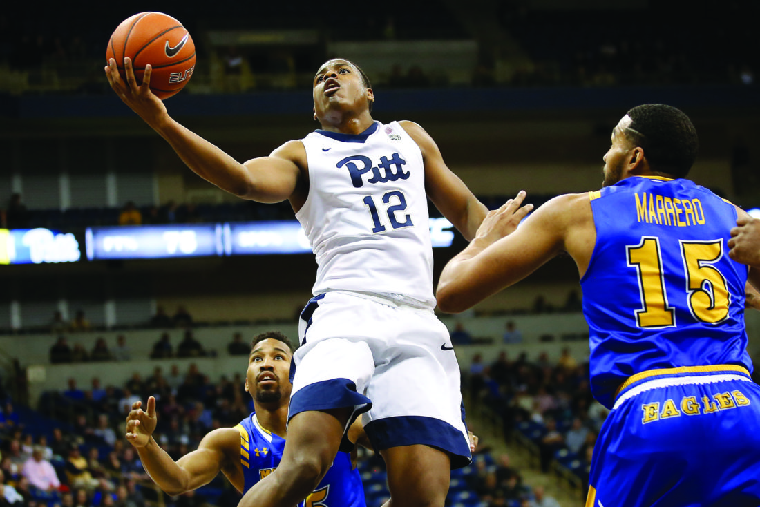 Pittsburgh guard Chris Jones (12) goes up for a layup in front of Morehead State forward DeJuan Marrero (15) during the second half of NCAA college basketball action at Petersen Events Center in Pittsburgh, Friday, Nov. 25, 2016.(AP Photo/Jared Wickerham)