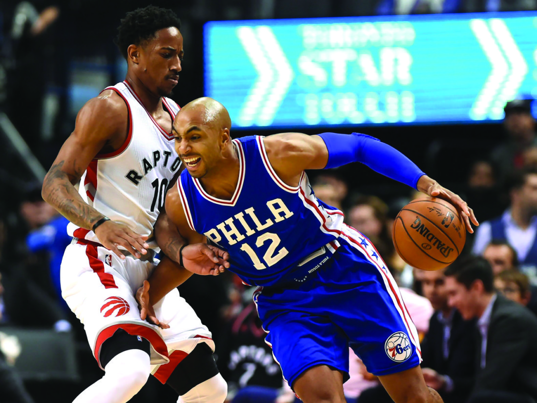 Toronto Raptors guard DeMar DeRozan (10) defends against Philadelphia 76ers guard Gerald Henderson (12) during first-half NBA basketball game action in Toronto, Monday, Nov. 28, 2016. (Nathan Denette/The Canadian Press via AP)
