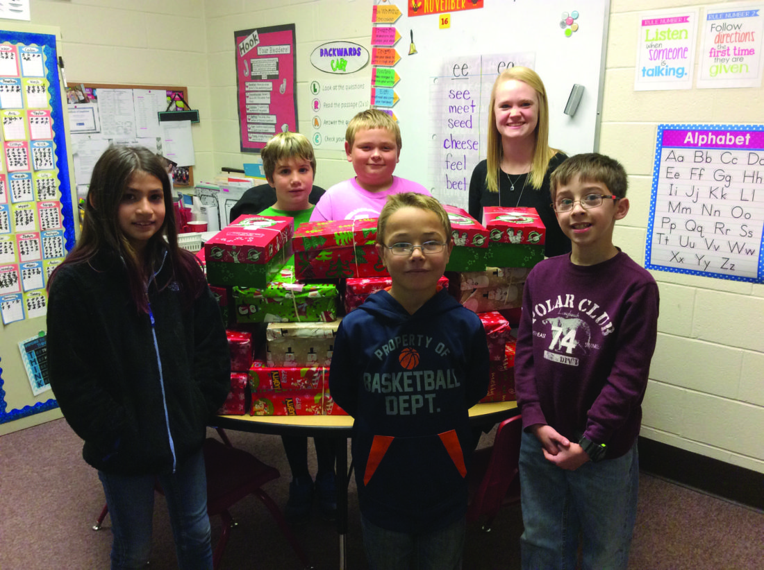 This photo shows, front row, from left, Cirstyn Watson, Mycah Carson, Remington Ripka; and back, Kai Fravel, Caden Hanley and Mrs. Zerby. The Liberty-Curtin students and teacher helped gather gifts for Operation Christmas Child.  PHOTO PROVIDED