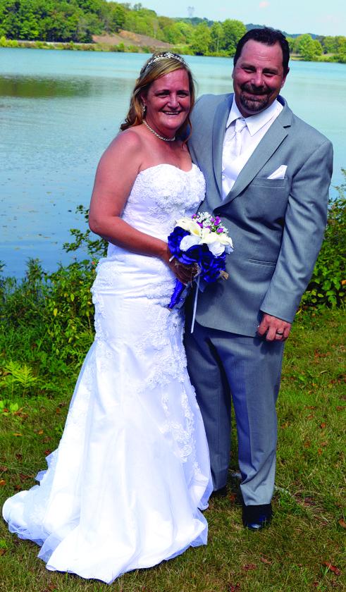 Mr. and Mrs. Robert P. King (Lauri Grace Workman)