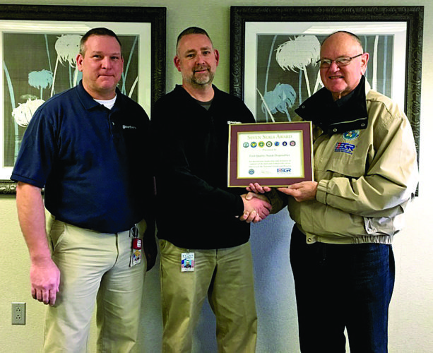 Photo Provided At right: Don Cole, center, of First Quality-Nutek in McElhattan received the Seven Seals Award for outstanding support he and his company provides to its Citizen Soldiers. Cole was nominated by Staff Sgt. Thomas Ritter, left. Presenting the award is William Burkhard, North Central Pennsylvania ESGR Area Chair.