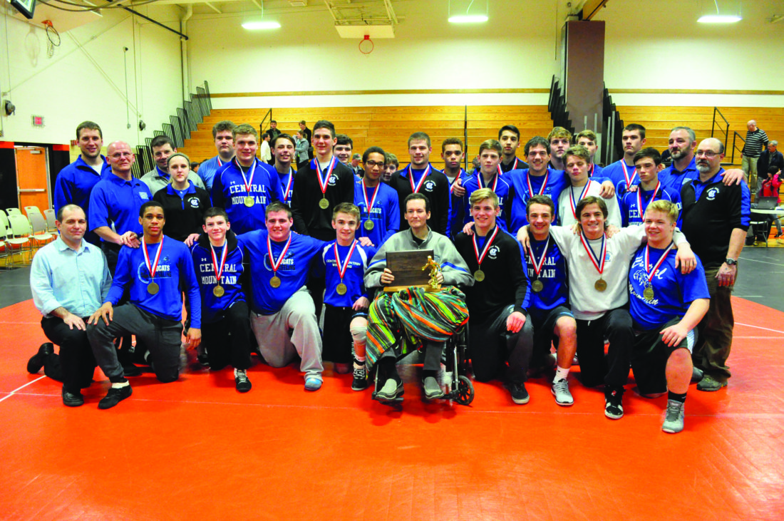Central Mountain High School celebrates winning the District 6 team wrestling championship. Justin Kline (center) poses with the team, he is the former mayor of Beech Creek and coach of the 2011 Keystone team that went to the LLWS. (The Express/Phil Mapstone)