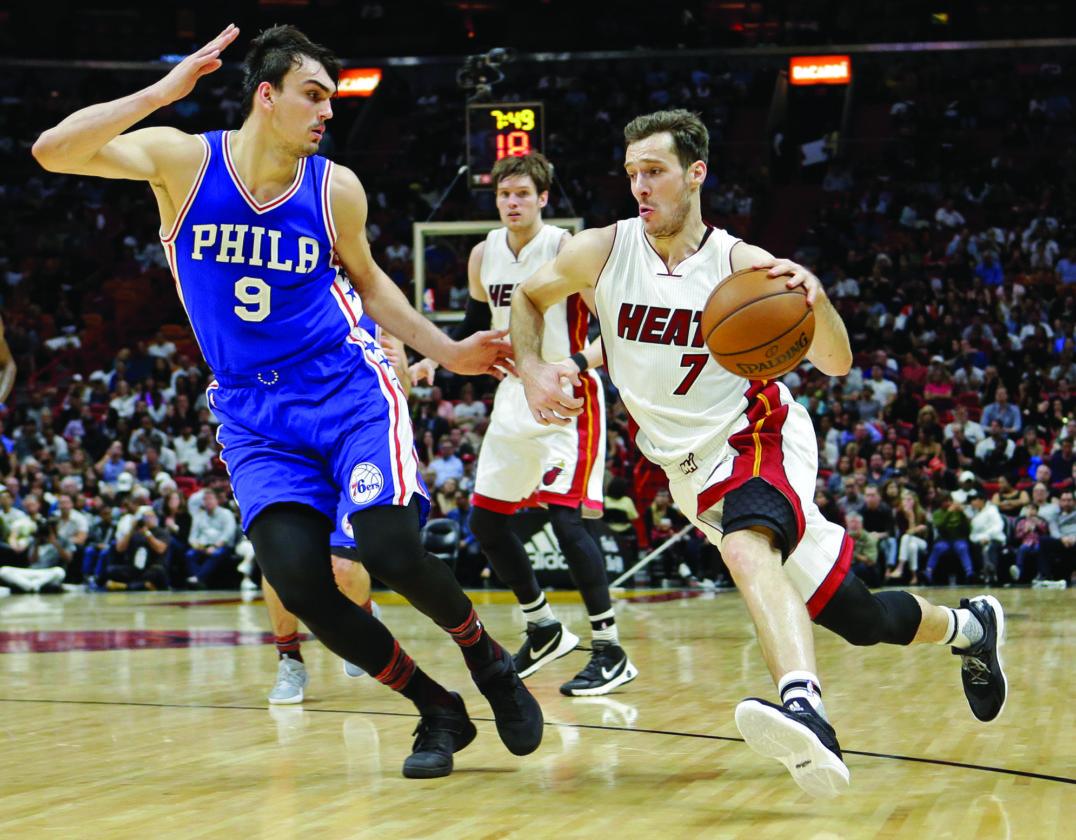 Miami Heat guard Goran Dragic (7) drives against Philadelphia 76ers forward Dario Saric (9) in the first half of an NBA basketball game, Saturday, Feb. 4, 2017, in Miami. (AP Photo/Alan Diaz)