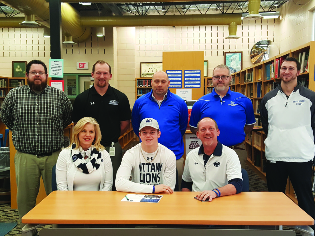 Justin Neff (bottom center) signs his letter of intent to play football at Penn State University. Neff was a star athlete in both basketball and football at Central Mountain High School. He sits beside his parents and Central Mountain staff behind him. (The Express/Shareik Flowers)