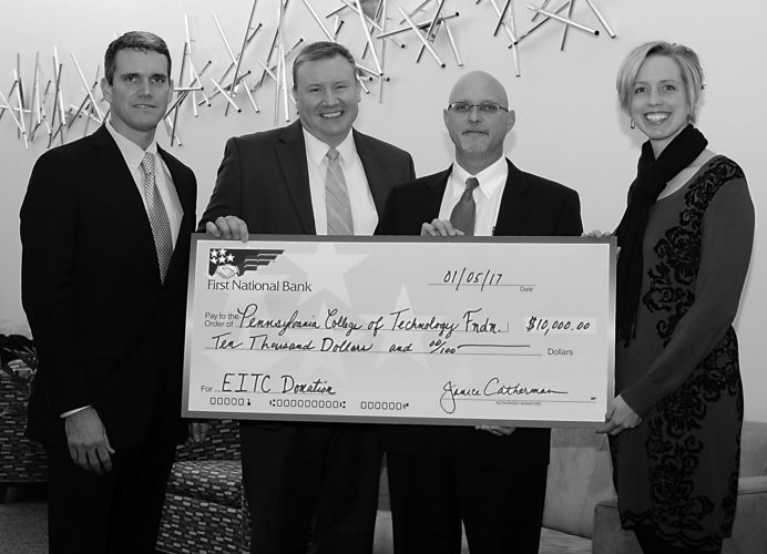 PHOTO PROVIDED Representatives of First National Bank present a $10,000 gift that will support two innovative educational programs offered by Penn College for high school students. From left are FNB's Don Breon, assistant vice president/treasury management; Dan Hooper, market manager/vice president; and Peter Bower, team leader/vice president, and Elizabeth A. Biddle, the college's director of corporate relations.