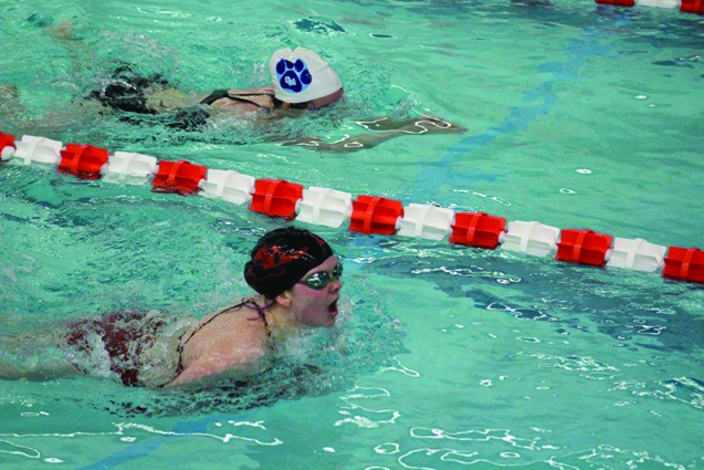 Jersey Shore's Allison Moore pushing ahead of Central Mountain's Eryn Bartlett in the 200 individual medley. (The Express/Michelle White)