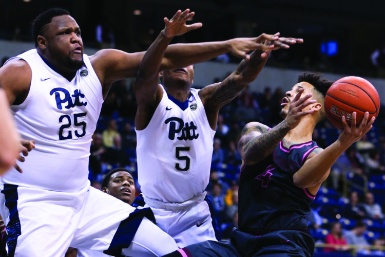Virginia Tech's Seth Allen (4) shoots as Pittsburgh's Rozelle Nix (25) and Justice Kithcart (5) defend during the first half of an NCAA college basketball game, Tuesday, Feb. 14, 2017, in Pittsburgh. (AP Photo/Keith Srakocic)