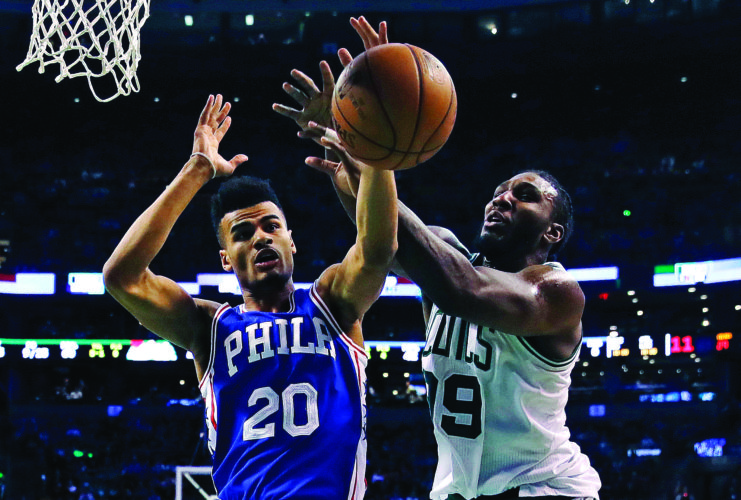 Boston Celtics forward Jae Crowder (99) and Philadelphia 76ers guard Timothe Luwawu-Cabarrot (20) battle for a rebound during the first quarter of an NBA basketball game in Boston, Wednesday, Feb. 15, 2017. (AP Photo/Charles Krupa)