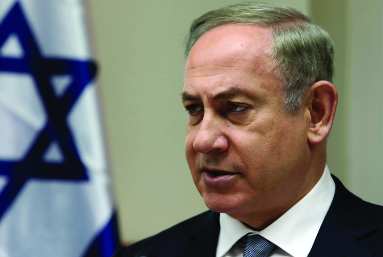 FILE - In this Sunday, Feb. 12, 2017, file photo, Israeli Prime Minister Benjamin Netanyahu chairs the weekly cabinet meeting in Jerusalem. IsraelÕs prime minister heads to Washington this week for a high-profile meeting with President Donald Trump that is suddenly clouded in uncertainty. After embracing IsraelÕs hard-line nationalist right throughout his presidential campaign, Trump appears to have softened some of his positions on key issues since taking office. (Gali Tibbon, Pool via AP, File)
