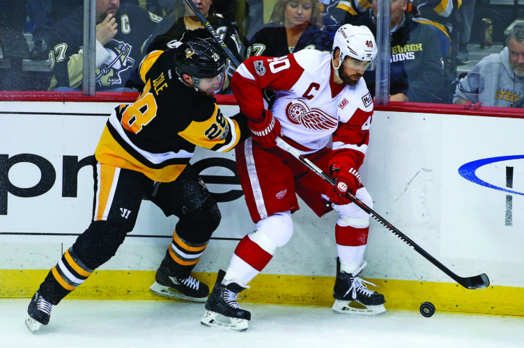 Detroit Red Wings' Henrik Zetterberg (40) works in the corner against Pittsburgh Penguins' Ian Cole (28) in the first period of an NHL hockey game in Pittsburgh, Sunday, Feb. 19, 2017. (AP Photo/Gene J. Puskar)